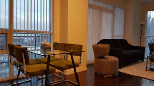 Large Furnished one bedroom with den with two Queen beds.