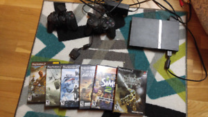 Play station 2 plus 2 controllers and six games