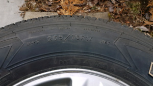 4 genuine Ford f150 rims and tires