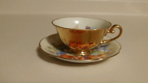 Antique hand-painted teacup and saucer
