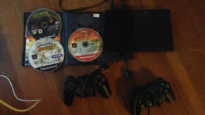 Ps2 with 2 controllers and 3 games