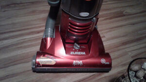 Eureka altima vacumn with telescopic self cleaning duster 40