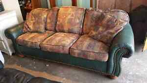LEATHER / PATTERN COUCH. DELIVERY IS EXTRA