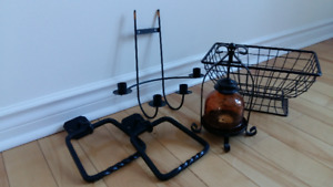 Black candle holders, towel rings and wire basket