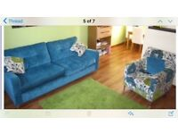 Teal sofa and armchair with matching cushions from DFS
