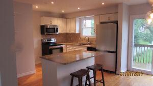 West End Semi- Hardwood floors and Granite countertops