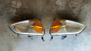 2003 Honda Civic Headlights (Plus Air Filter Fram 8911)