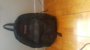 LIFE TIME WARRANTY BLACK JANSPORT REVERSABLE