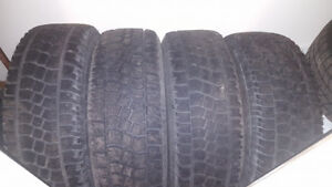 Four Dodge Ram 1500 winter rims and tires.
