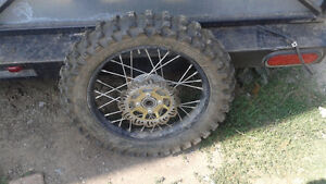 LIKE NEW pirelli scorpion 90/100-14 dirtbike tire on front rim