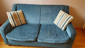 SMALL 2 SEATER TEAL SOFA. CONVERTS TO SOFA BED FOR OCCASIONAL USE.