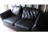 Two seater leather sofa - dark brown