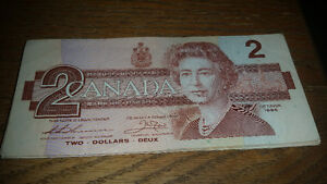 25 1986 vintage canadian $2 bills only 85$ see my other ads!!!!!