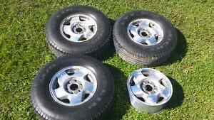 4 Chevy/GMC rims with 3 tires - $150 OBO