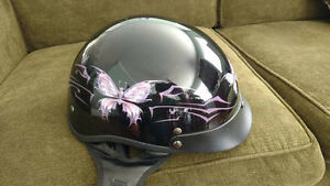 .Motorcycle or scooter helmet with butterfly designs