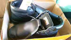 Absolutely brand new stc steel toe boots still in box all tags
