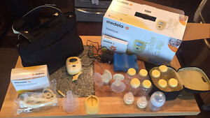 Medela Freestyle Breast Pump with extras!