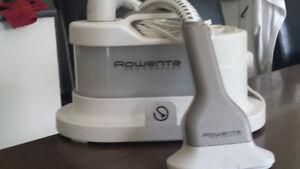 Machine à vapeur pour défroisser Rowenta compact.