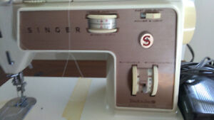 Singer sewing machine and table. Model Touch And Sew 758.