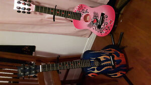 Boy and girl guitar with stands