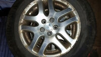 "4 - 16""  subaru alloy wheels and one spare steel wheel and tire"