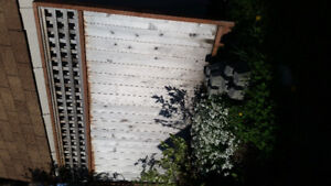 Wood dividing wall and 2 blocks to hold it upright for sale $75