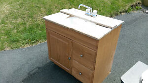 Bathroom Sink with solid oak cabinet and marble top.