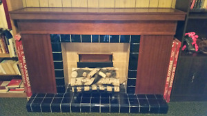 Portable fireplace mantle  with decorative logs