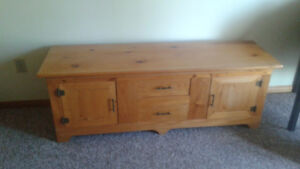 Pine table with end door open and 2 drawers in the middle