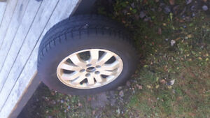 winter tires and rims  5 bolt rims
