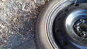 4  studded winter tires on 5x100 rims Moose Jaw Regina Area image 3