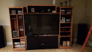 TV shelving unit (like new) and T.V Included- Must go