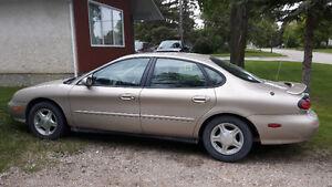 1999 Ford Taurus S/E  Widowed twice !