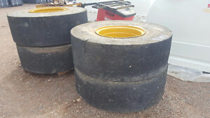 (4) Solid Primex 20.5R25 with Rims