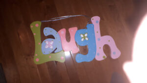 LAUGH Sign with butterflies.