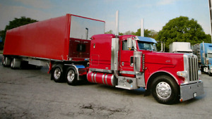 389 Peterbilt and Mac flat bed trailer with roll'tite