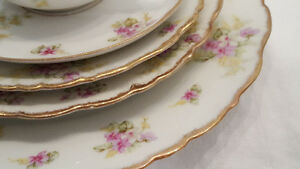 Antique Elite Limoges china with gold rims and pink roses