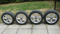Four Ford Mustang wheels