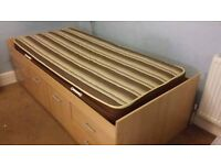 Cabin bed with underbed storage space