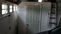 Drywall work and Install a door job in garage