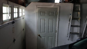 Drywall work and Install a door in garage