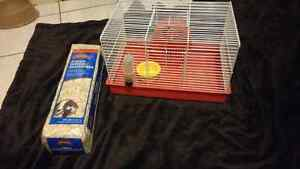 Hamster cage with bag of bedding