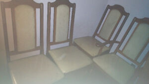 large wooden table and 6 antique chairs