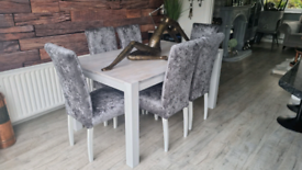 Stunning solid wood dining table together with six grey velvet chairs