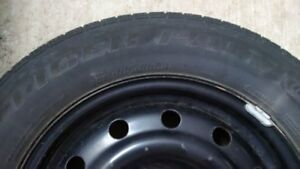 4 used snow tires with rims, Uniroyal Tiger Paw