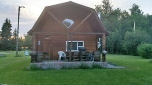 Log cabin for sale on large lot located in Buck Lake Alta.