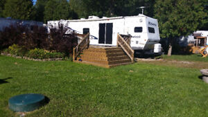 38ft trailer on beautiful lot at Emerald Lake