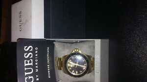 Mens Gold Guess watch.