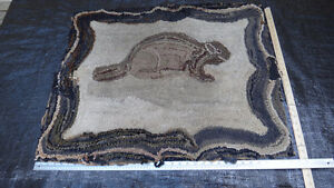 Antique beaver hooked rug