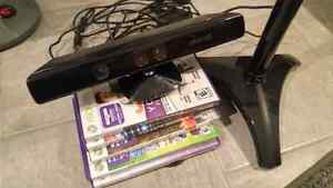 Xbox 360 Kinect, 5 games and kinect stand.